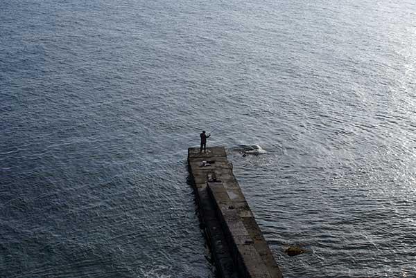 Рыбалка с пирса фото